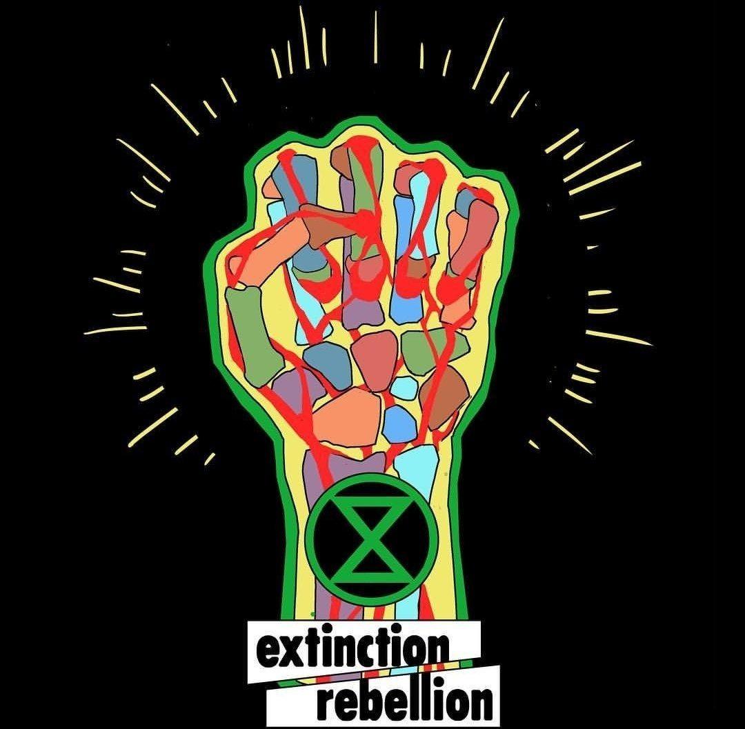 Hora de rebelarse: puño cerrado de Extinction Rebellion