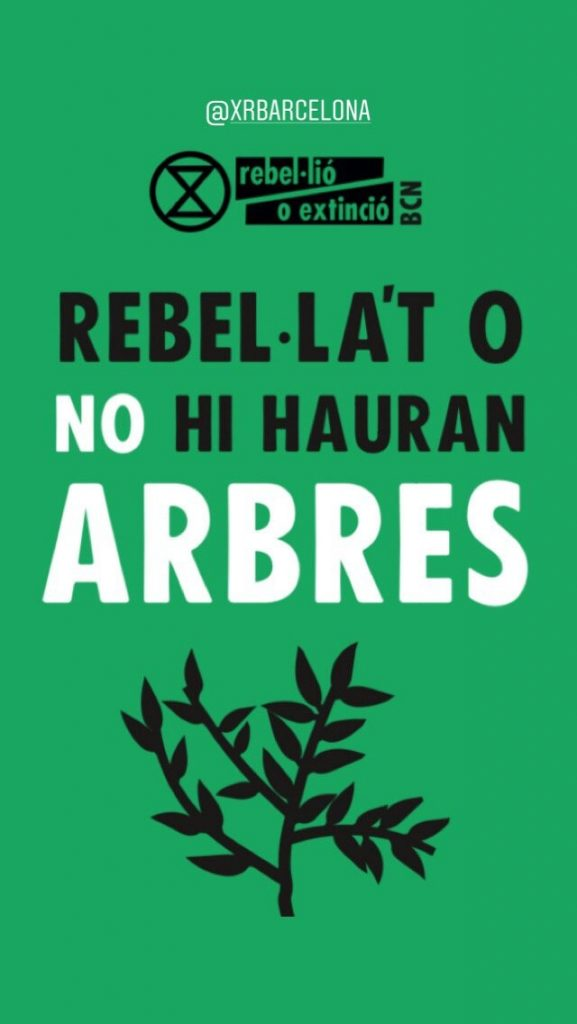 "Banner: ""Rebel or there will be no trees"" (in Catalan)"