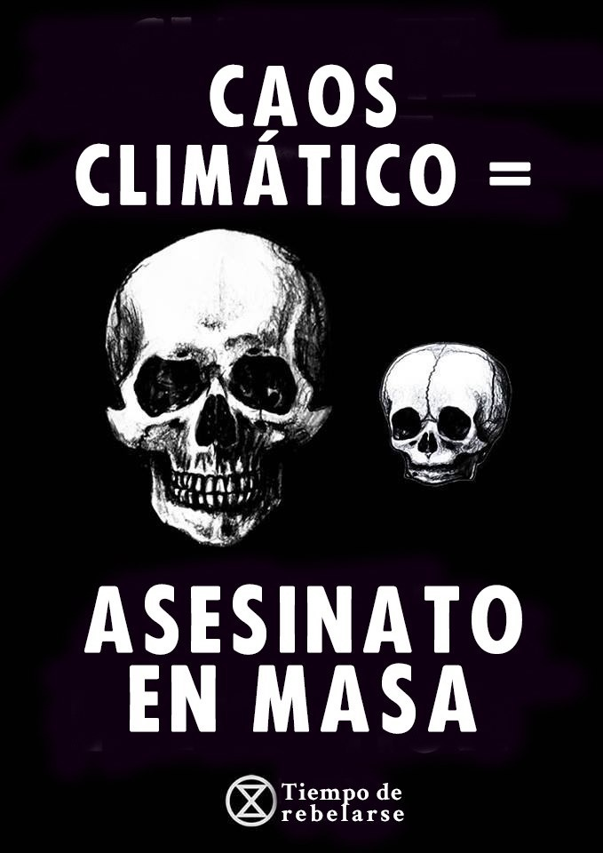 "Banner: ""Climate chaos = mass murder"" (in Castellano)"
