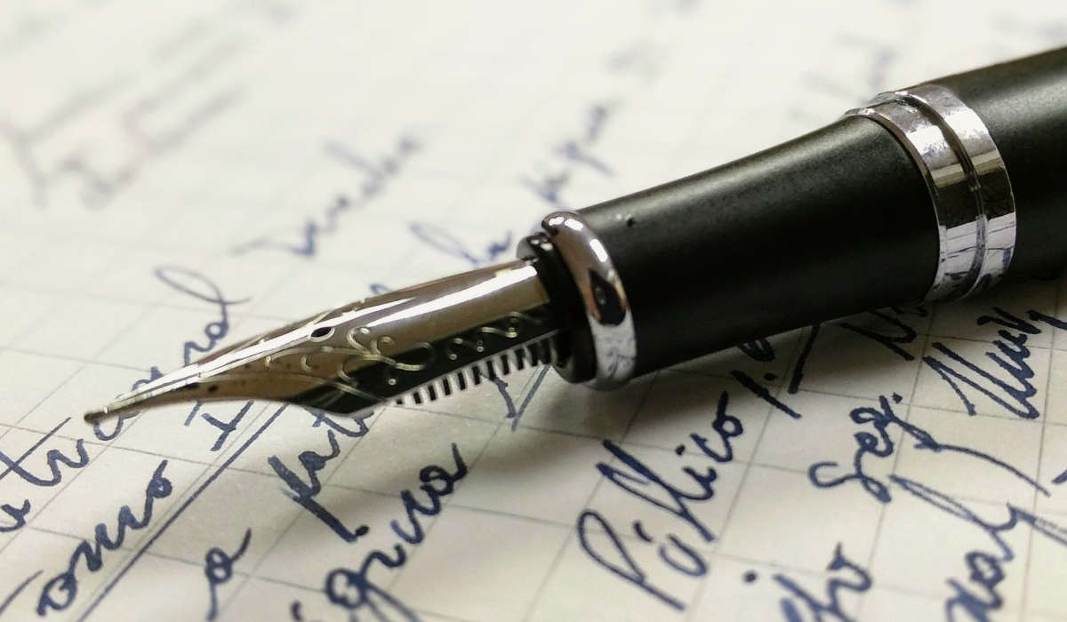 Image of a pen and a letter