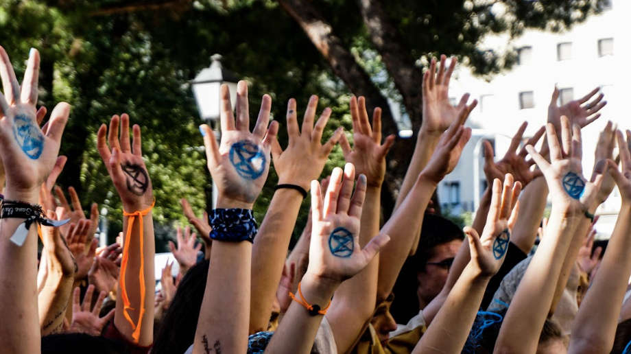 Image of raised hands:  Together we're stronger