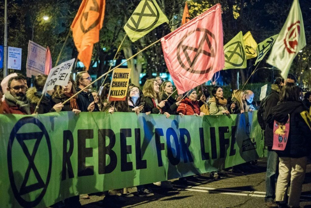 "Banner carried during a demonstration ""Rebel for life"""