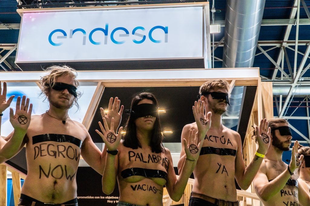Action in front of Endesa stand during COP25